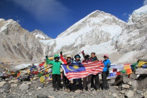 May 1, 2013 - Kang Nee (3rd from left) and her Malaysian team-mates at Everest Base Camp, Nepal. In the immediate background, prayer flags are seen fluttering among barren rocks. The summit of Everest itself is not visible in this photo.