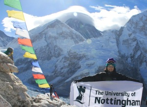 May 2, 2013 - Kang Nee at the peak of Kala Patthar (5,550m). Mt Everest is clearly visible in the background, with the peak covered by clouds.